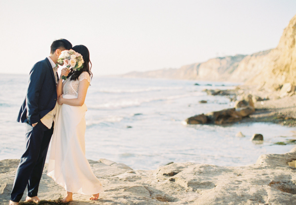 beach and sand engagement photo by Matoli Keely Photography