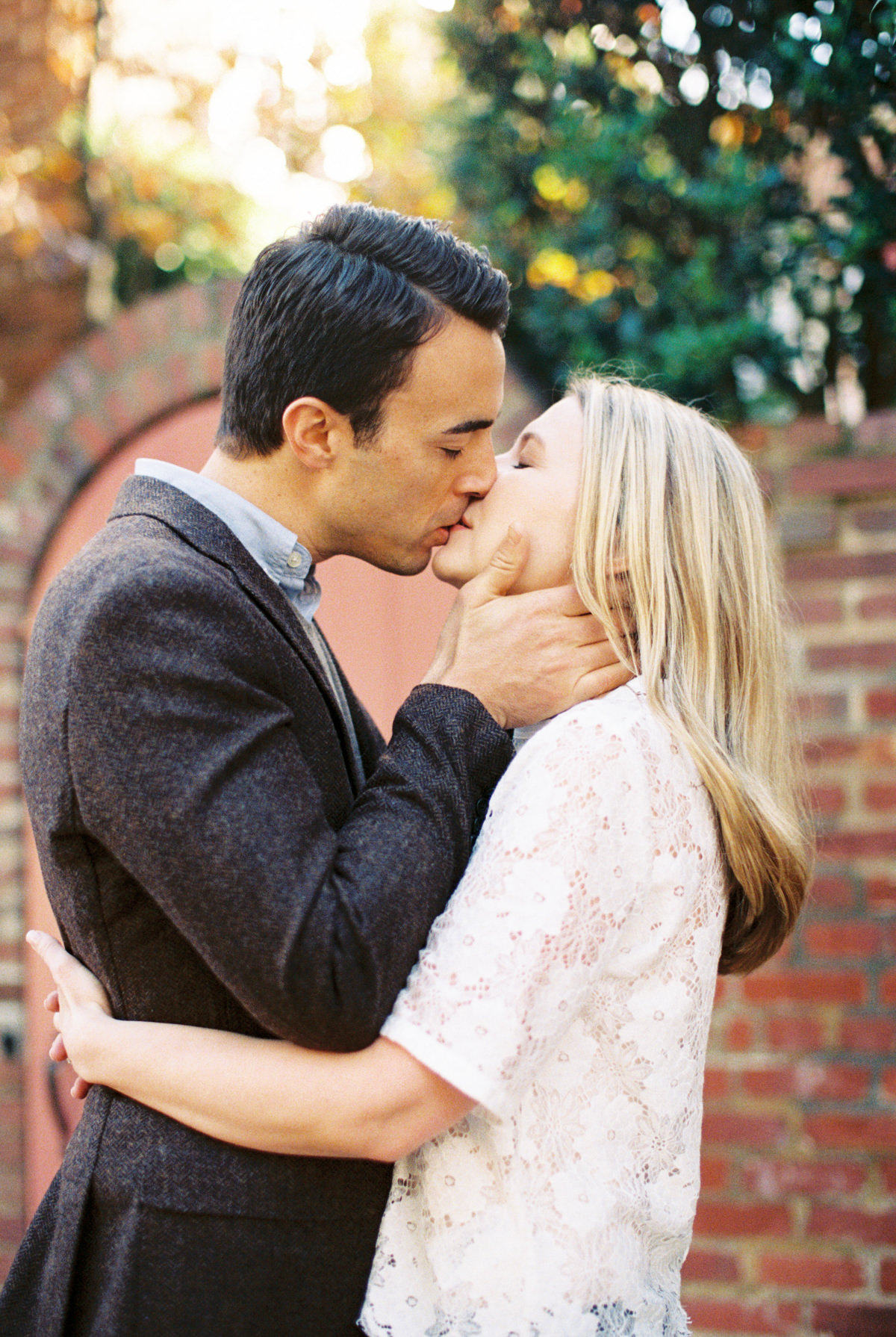 romantic kiss engagement photo by Matoli Keely Photography
